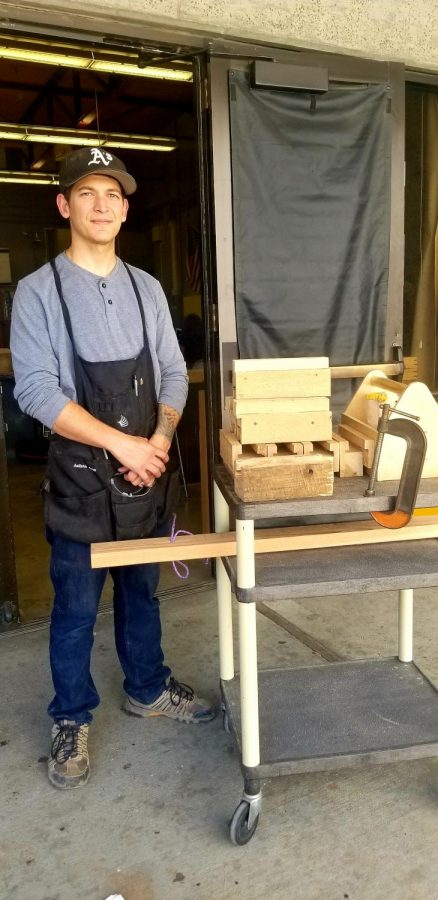 Samuel+Scianna+outside+his+class+with+the+cart+he+uses+to+take+the+wooden+barricades+from+classroom+to+classroom.